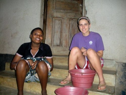 Removing rocks from buckets of beans in Tanzania.