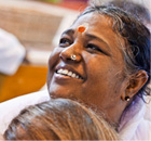 Amma is known for her embrace but also for her compassion and humanitarianism